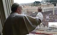 Newly elected Pope Francis appears at the window of his future private apartment to bless the faithful, gathered below in St. Peter's Square, during the Sunday Angelus prayer at the Vatican March 17, 2013. REUTERS/Osservatore Romano