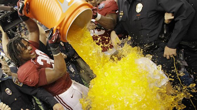 Alabama head coach Nick Saban is dunked by Dont'a Hightower (30) after the BCS National Championship college football game against LSU Monday, Jan. 9, 2012, in New Orleans. Alabama won 21-0. (AP Photo/David J. Phillip)