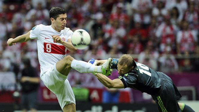 Russia goalkeeper Vyacheslav Malafeev makes a save in front of Poland's Robert Lewandowski during the Euro 2012 soccer championship Group A match between Poland and Russia in Warsaw, Poland, Tuesday, June 12, 2012. (AP Photo/Alik Keplicz)