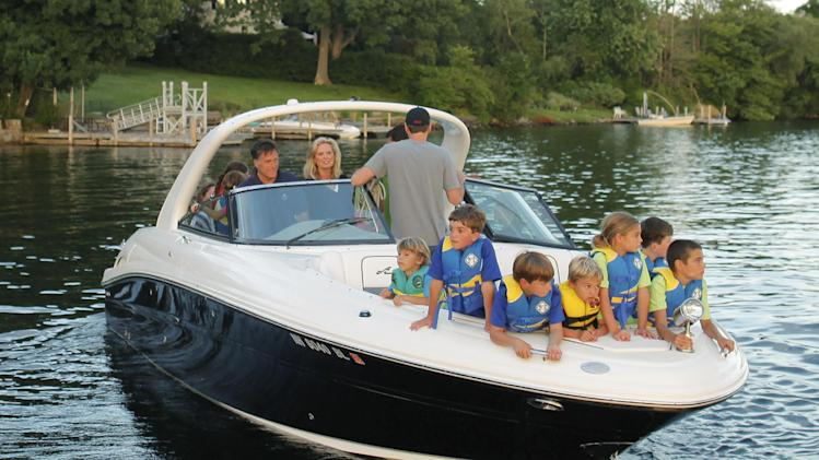 Republican presidential candidate Mitt Romney, rear left, and his wife Ann, with their grandchildren in the bow of their boat, depart from the public docks on Lake Winnipesaukee in Wolfeboro, N.H., Monday, July 2, 2012, as they continue their vacation from the campaign trail. (AP Photo/Charles Dharapak)
