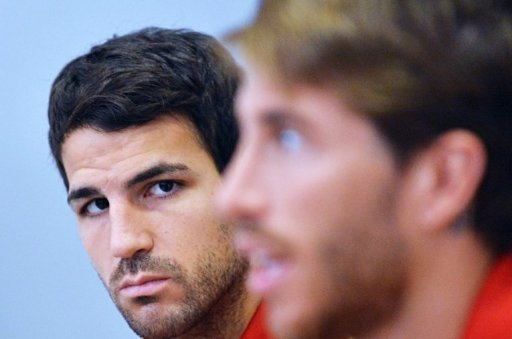 Spanish defender Sergio Ramos (R) and midfielder Cesc Fabregas attend a press conference in Kiev on June 29