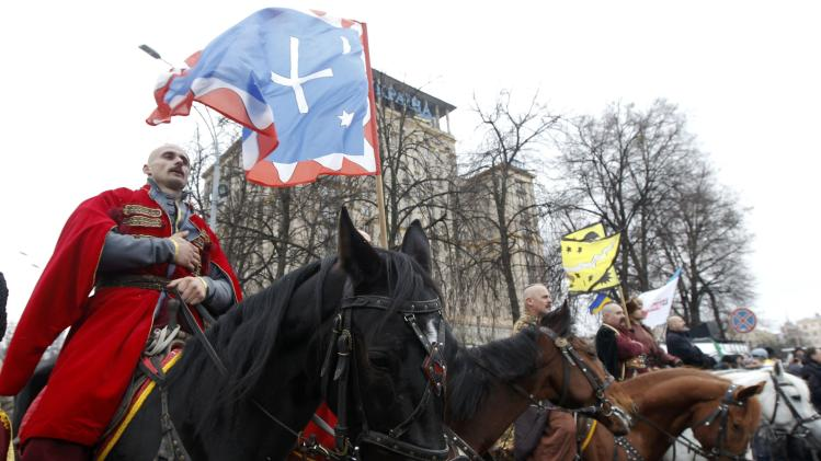 Men aboard horses sing the national anthem during a rally organized by supporters of EU integration at Maidan Nezalezhnosti or Independence Square in central Kiev