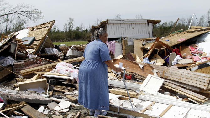 June White searches through what is left of Moore's Family Care Home in Colerain, N.C., Monday, April 18, 2011 after a tornado ripped through the area Saturday.  (AP Photo/Jim R. Bounds)