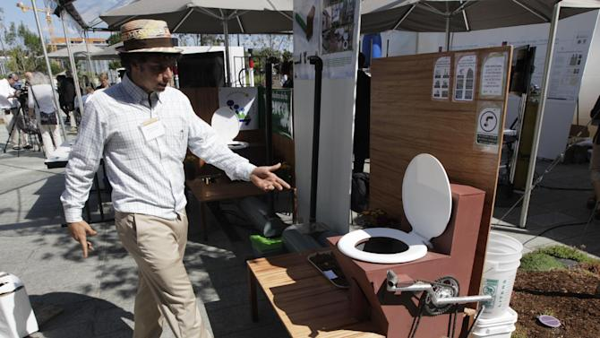 "Marcos Fiovavanti, of the Ecuador-based ""Fundacion In Terris"" group, talks about the ""Earth Auger Toliet,"" which is operated by a mechanical pedal and chain system, on display at the ""Reinventing the Toliet"" Fair, Tuesday, Aug. 14, 2012, in Seattle, which is part of a Bill & Melinda Gates Foundation competition to reinvent the toilet for the 2.6 billion people around the world who don't have access to modern sanitation. (AP Photo/Ted S. Warren)"