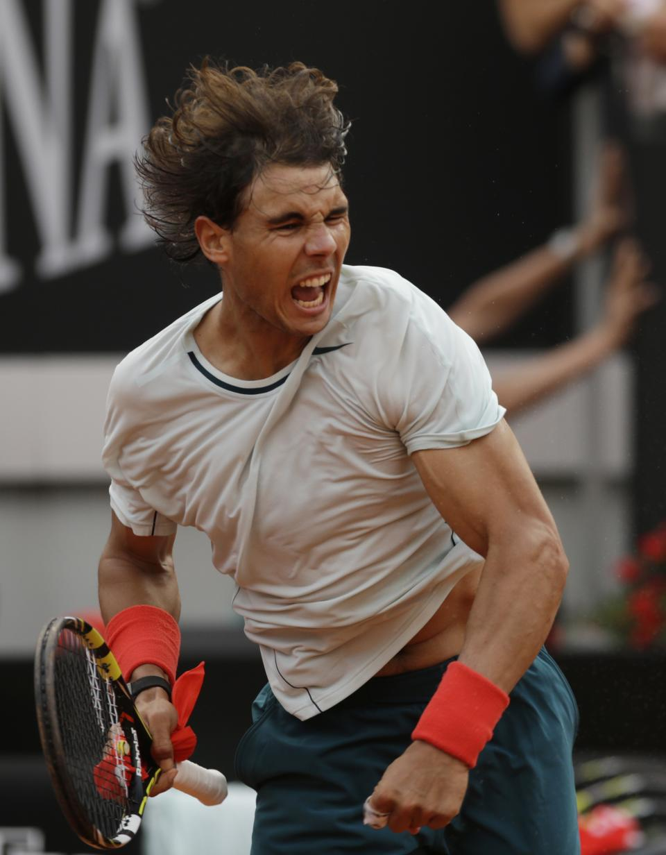 Spain's Rafael Nadal celebrates after defeating Latvia's Ernests Gulbis during their match at the Italian Open tennis tournament in Rome, Thursday, May 16, 2013. Nadal won 1-6, 7-5, 6-4. (AP Photo/Andrew Medichini)