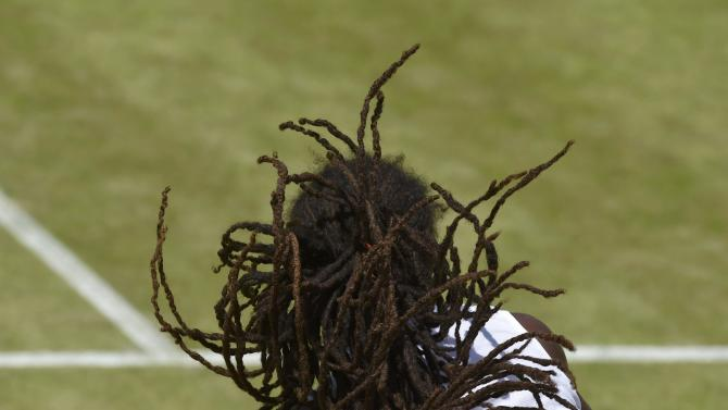 Dustin Brown of Germany serves during his match against Viktor Troicki of Serbia at the Wimbledon Tennis Championships in London