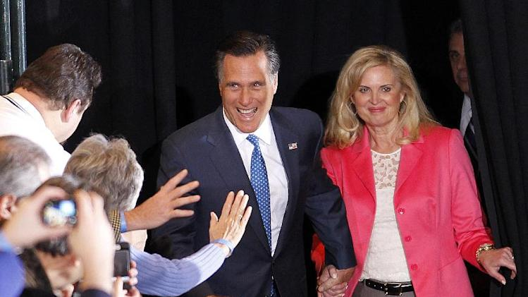 Republican presidential candidate, former Massachusetts Gov. Mitt Romney, and his wife Ann greet supporters as they arrive at their Super Tuesday primary night rally in Boston, Tuesday, March 6, 2012. (AP Photo/Gerald Herbert)