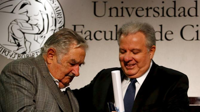 Former Uruguay President Jose Mujica is awarded with an honorary doctorate from the University of Buenos Aires, at the School of Economics, by dean Alberto Barbieri in Buenos Aires