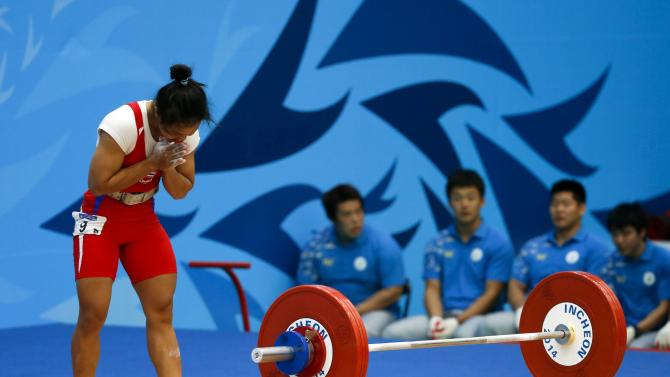 Thailand's Panida Khamsri reacts after a lift in the women's 48kg snatch weightlifting competition at the Moonlight Festival Garden during the 17th Asian Games in Incheon