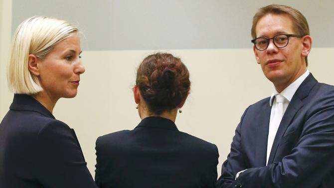 Defendant Zschaepe stands between her lawyers Sturm and Heer as they wait for continuation of her trial in Munich