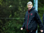 Arsene Wenger is happy to succeed despite being accused of 'not spending fortunes'