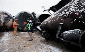 NTSB member Robert Sumwalt views damaged rail cars at the scene of the BNSF train accident in Casselton