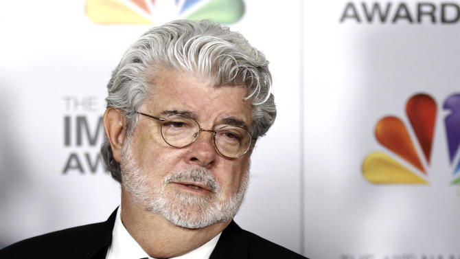 """FILE - In this Feb. 17, 2012 file photo, George Lucas arrives at the 43rd NAACP Image Awards in Los Angeles. A decade after George Lucas said """"Star Wars"""" was finished on the big screen, a new trilogy is destined for theaters after The Walt Disney Co. announced Tuesday, Oct. 30, 2012, that it was buying Lucasfilm Ltd. for $4.05 billion.  (AP Photo/Matt Sayles File)"""