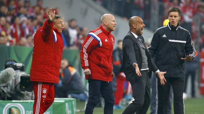 Bayern Munich's coach Guardiola reacts reacts after appealing unsuccessfully for a hand ball during German Cup semi-final soccer match against Borussia Dortmund in Munich