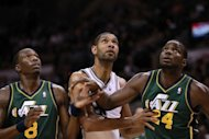 San Antonio Spurs' Tim Duncan (C) waits for the rebound with Josh Howard (L) and Paul Millsap (R) of the Utah Jazz during game two of the NBA Western Conference first-round playoff series on May 2. San Antonio pummelled Utah 114-83 to take a 2-0 lead