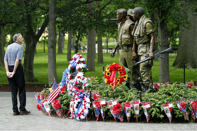 A visitor looks at the monument of the Vietnam Veterans Memorial in Washington on Sunday,  May 29,  2011. Motorcyclists are in Washington for the traditional annual Rolling Thunder events during the M