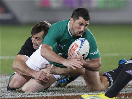 Ireland&#39;s Rob Kearney is tackled by All Black&#39;s Conrad Smith during their test match at Eden Park in Auckland