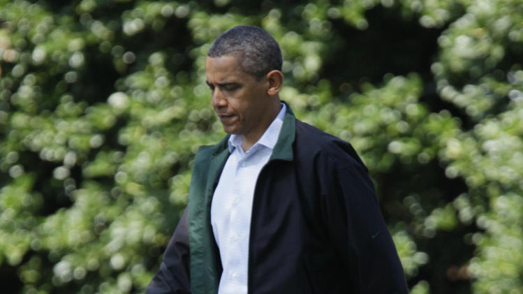 President Barack Obama walks from the Oval Office of the White House to board Marine One, Saturday, July 9, 2011, in Washington, as he travels to Camp David, the Presidential retreat in Catoctin Mountains. (AP Photo/Carolyn Kaster)
