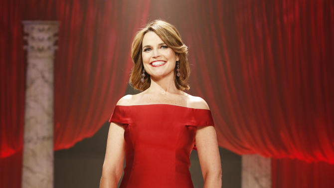FILE - In this Feb. 6, 2013 file photo, Savannah Guthrie walks the runway at the Red Dress Collection 2013 Fashion Show in New York.  Guthrie reported Monday, May 13, 2013, that her boyfriend Mike Feldman had proposed during a tropical vacation, and she said yes. Guthrie and Feldman, a consultant at a strategic communications firm in Washington, have been dating for four years. (Photo by John Minchillo/Invision/AP, File)
