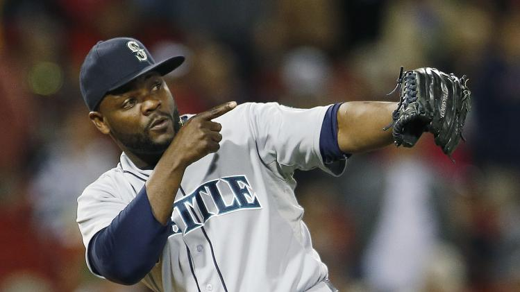 Seattle Mariners' Fernando Rodney celebrates after defeating the Boston Red Sox 5-3 in a baseball game in Boston, Friday, Aug. 22, 2014. (AP Photo/Michael Dwyer)