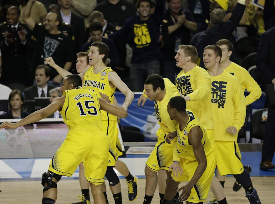Michigan players react after the second half of the NCAA Final Four tournament college basketball semifinal game against Syracuse, Saturday, April 6, 2013, in Atlanta. Michigan won 61-56. (AP Photo/Chris O'Meara)