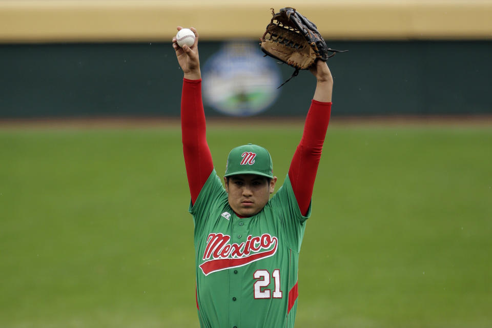 Nuevo Laredo, Mexico's Felix Diaz stretches before pitching in the first inning of a pool play baseball game against Taoyuan County, Taiwan at the Little League World Series, Monday, Aug. 20, 2012, in South Williamsport, Pa. Mexico won 4-3. (AP Photo/Matt Slocum)