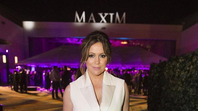 Alyssa Milano arrives at the 2015 Maxim Super Bowl Party on Saturday, Jan. 31, 2015, in Scottsdale, Ariz. (Photo by Colin Young-Wolff/Invision/AP)