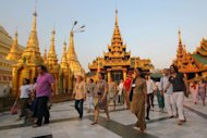 Tourists walk around the Shwedagon pagoda in Yangon. Last week, European Union nations put a halt to most sanctions against the impoverished nation for one year to reward a series of dramatic reforms since direct army rule ended last year
