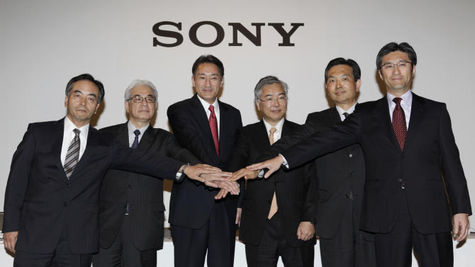 Sony Corp. President and Chief Executive Officer Kazuo Hirai, third from left, poses for photographers with the corporate executives, from left, Executive Deputy President Hiroshi Yoshioka, Executive Vice President and Chief Financial Officer Masaru Kato, Hirai, EVP Tadashi Saito, EVP Shoji Nemoto, and EVP Kunimasa Suzuki after a press conference in Tokyo, Thursday, April 12, 2012. Hirai outlined his business strategy and pledged to revive the electronics and entertainment company. (AP Photo/Shizuo Kambayashi)