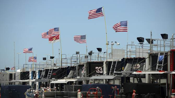 Flags fly over NASCAR Sprint Cup team haulers to celebrate Independence Day before an auto race practice at Daytona International Speedway, Thursday, July 4, 2013, in Daytona Beach, Fla. (AP Photo/Phelan M. Ebenhack)