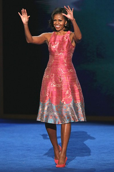 The First Lady looked pretty in a pink and blue floral dress and matching J. Crew Everly suede pumps. It just goes to show that women can look fashionable without spending a lot of money.  Obama has s