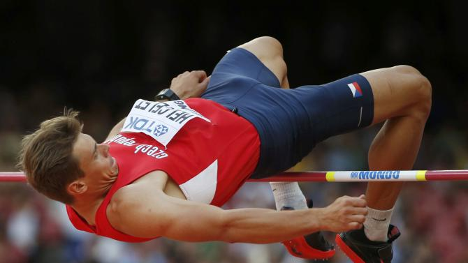 Helcelet of Czech Republic competes in the high jump event of the men's decathlon during the 15th IAAF World Championships at the National Stadium in Beijing