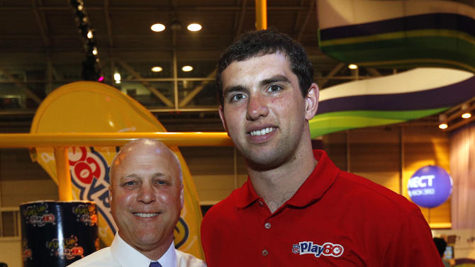 Indianapolis Colts Quarterback Andrew Luck, right, and New Orleans Mayor Mitch Landrieu, left, pose for a photo at the Quaker's NFL Experience in New Orleans on Wednesday, Jan. 30, 2013. (Jonathan Bachman / AP Images for Quaker Oats)
