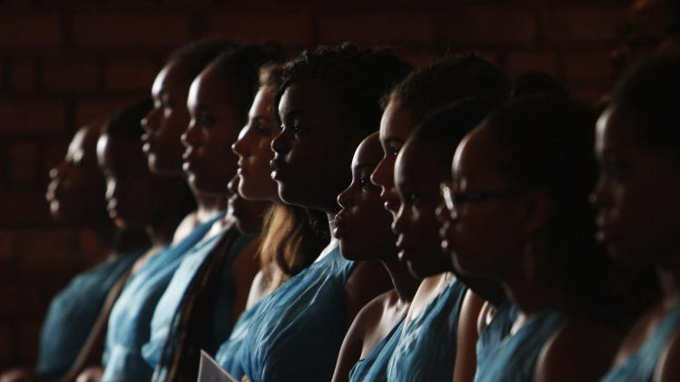 St Mary's church choir sings during a memorial service for former South African President Mandela in Singapore