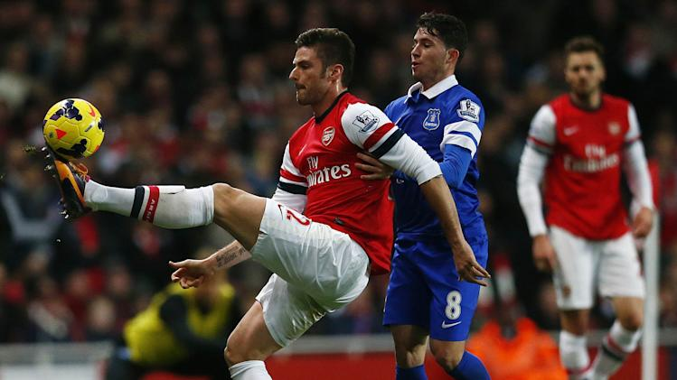 Everton's Oviedo challenges Arsenal's Giroud during their English Premier League soccer match against The Emirates in London