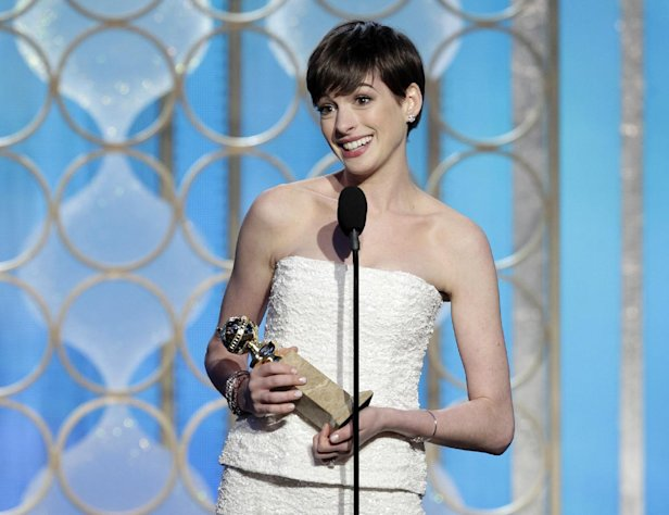 This image released by NBC shows Anne Hathaway with her award for best supporting actress in a motion picture for her role in &quot;Les Miserables&quot; during the 70th Annual Golden Globe Awards at the Beverly Hilton Hotel on Jan. 13, 2013, in Beverly Hills, Calif. (AP Photo/NBC, Paul Drinkwater)