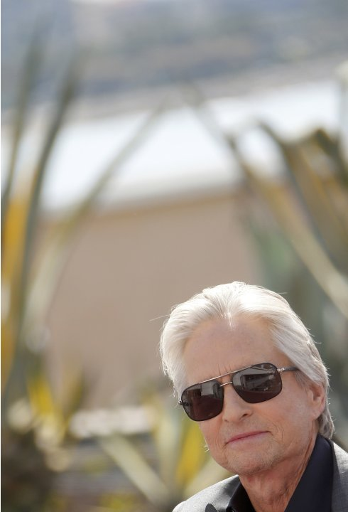 "Cast member Michael Douglas arrives at a photocall for the film ""Behind the Candelabra"" during the 66th Cannes Film Festival in Cannes"