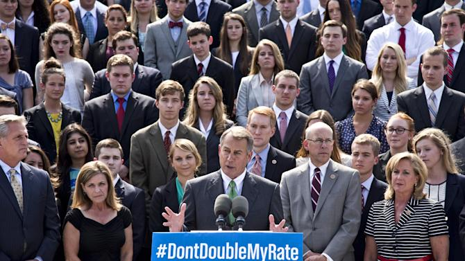 In this July 8, 2013, photo, with a backdrop of college students on the step of the House of Representatives, Speaker of the House John Boehner, R-Ohio, center, and GOP leaders talk about the politics of federal student loan rates which doubled on July 1, at the Capitol in Washington. Senate Democrats are trying to restore lower interest rates on student loans. A procedural vote is scheduled for Wednesday on a Senate measure that would return rates on subsidized Stafford loans to 3.4 percent for one year. An earlier attempt in the Senate to keep rates low came up short and those loans' rates doubled to 6.8 percent on July 1. (AP Photo/J. Scott Applewhite)