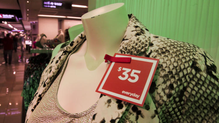 "In this June 8, 2012 photo, a red ""everyday"" pricing tag is attached to clothes on display at a J.C. Penney store in New York. Six months after J.C. Penney got rid of the hundreds of sales it offers each year in favor of a three-tier pricing approach, the mid-priced department store chain is revamping its pricing strategy again. (AP Photo/Bebeto Matthews)"