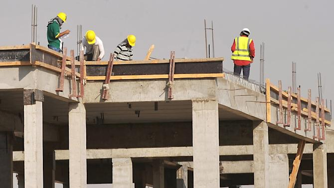 Foreign laborers work at a construction site in the Saudi capital Riyadh on October 30, 2013