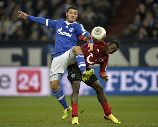 Schalke's Sead Kolasinac, left, and Hannover's Mame Diouf challenge for the ball during the German Bundesliga soccer match between FC Schalke  and SV Hannover in Gelsenkirchen,  Germany, Sunda