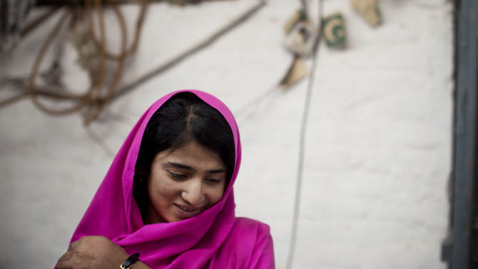 In this Wednesday, Nov. 14, 2012 photo, Shazia Ramazan, 13, is seen at her home in Mingora, Swat Valley, Pakistan, after  being  wounded by the same Taliban gunman, who shot Malala Yousufzai and 16-year-old Kainat Riaz Oct 8, 2012 on their way coming back from school. Malala was shot for her outspoken insistence on girls education. Shazia and Kainat are to return to school this week for the first time since the shooting more than one month ago. (AP Photo/Anja Niedringhaus)