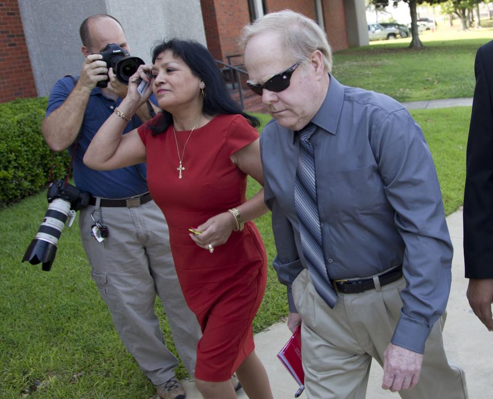Harvey Updyke arrives with his wife Elva at the Lee County Justice Center in Auburn, Ala., Tuesday, June 19, 2012.  Jury selection is scheduled to begin in his trial where Updyke is accused of poisoning Toomer's Corner's historic oak trees on the campus of Auburn University. (AP Photo/Dave Martin)