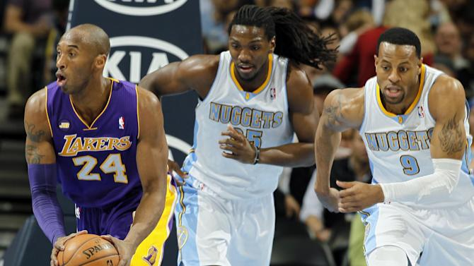Los Angeles Lakers guard Kobe Brant, left, picks up a loose ball in front of Denver Nuggets forward Kenneth Faried, center, and guard Andre Iguodala in the first quarter of an NBA basketball game in Denver on Monday, Feb. 25, 2013. (AP Photo/David Zalubowski)