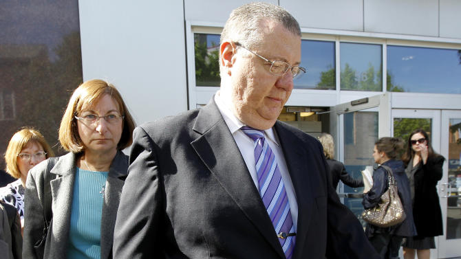 Joe Clementi, foreground, and his wife, Jane, walk outside of the Middlesex County Courthouse, where Molly Wei had a hearing in the webcam-spying case involving the suicide of their son Tyler Clementi, Friday, May 6, 2011 in New Brunswick, N.J. Wei has entered a pretrial intervention program that could keep her from getting a criminal record if she meets certain conditions _ including cooperating with the prosecution of the more serious charges against the other defendant in the case. (AP Photo/Julio Cortez)