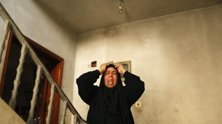 A relative of Palestinian man Adnan Habib, who medics said was killed by Israeli shelling, mourns during his funeral in Gaza City