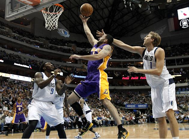 Dallas Mavericks' Jae Crowder (9) and Dirk Nowitzki, of Germany, defend against a shot by Los Angeles Lakers' Jordan Farmar (1) in the first half of an NBA basketball game, Tuesday, Nov. 5, 2013, in D
