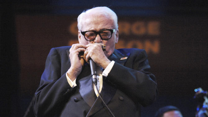 FILE - In an Oct. 17, 2008 file photo provided by the National Endowment for the Arts, Belgian-born Toots Thielemans performs at the Rose Theater in New York. On Saturday, Sept. 29, 2012,Thielemans quipped that his legs don't work but his mouth does after he was pushed onstage in a wheelchair to a standing ovation during the first of two Jazz at Lincoln Center concerts this weekend celebrating his 90 years.  (AP Photo/National Endowment for the Arts, Tom Pich, File) NO SALES