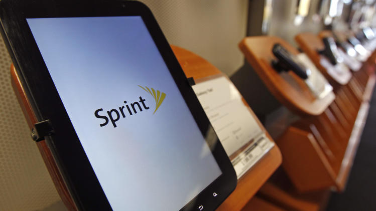 A Samsung Galaxy Tab tablet is displayed at the Sprint store in Stoneham, Mass., Tuesday, Oct. 25, 2011. Sprint is reporting its smallest quarterly loss in four years, as it's continuing a turnaround and getting better at keeping and attracting customers.   (AP Photo/Charles Krupa)