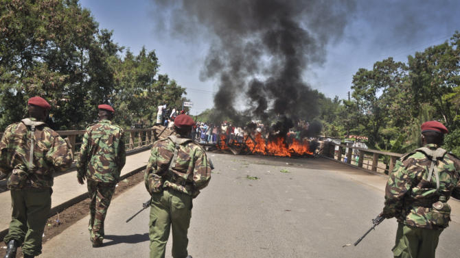 Security forces move in after demonstrators set up burning tyre roadblocks to protest the results of the Orange Democratic Movement (ODM) primary elections, in the town of Ahero near Kisumu in western Kenya Sunday, Jan. 20, 2013. Political parties in Kenya this week held their internal elections to decide candidates who will vie for gubernatorial, senate, county, and women representatives seats in the upcoming March 4 elections, a process which was fraught with irregularities, disorganization and disgruntled losers, increasing the chances of conflict during the upcoming vote, analysts said on Friday. (AP Photo)